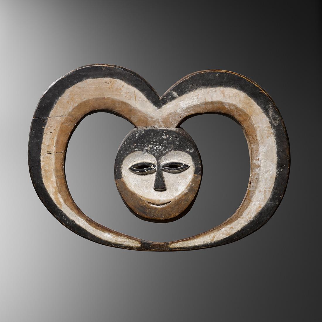 1. masque kwele
